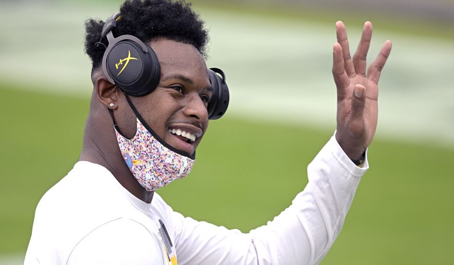Pittsburgh Steelers wide receiver JuJu Smith-Schuster waves to fans during warm ups before an NFL football game against the Jacksonville Jaguars, Sunday, Nov. 22, 2020, in Jacksonville, Fla. (AP Photo/Phelan M. Ebenhack)