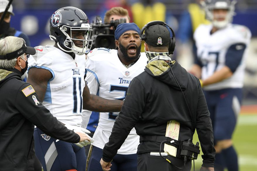 Baltimore Ravens head coach John Harbaugh, right, argues with Tennessee Titans cornerback Malcolm Butler, center, and wide receiver A.J. Brown (11) prior to an NFL football game, Sunday, Nov. 22, 2020, in Baltimore. (AP Photo/Nick Wass)