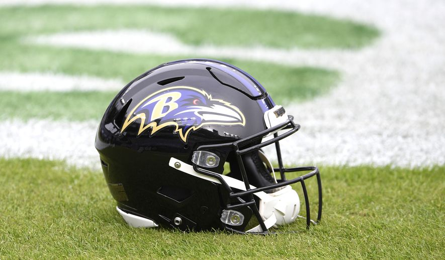 A Baltimore Ravens helmet is seen on the field prior to an NFL football game against the Tennessee Titans, Sunday, Nov. 22, 2020, in Baltimore. (AP Photo/Nick Wass)  **FILE**