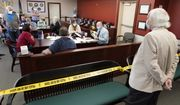 An observer watches as Luzerne County workers canvas ballots. (AP Photo/Mary Altaffer, File)