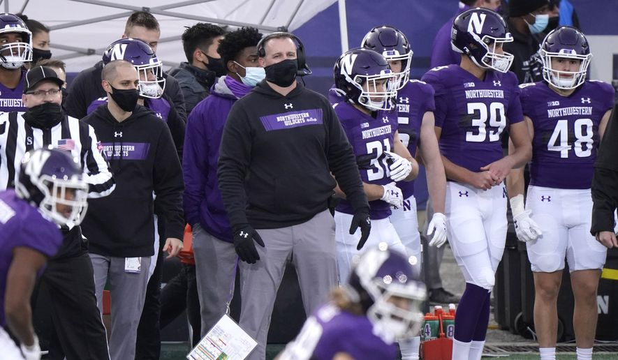 Northwestern head coach Pat Fitzgerald watches his team during the first half of an NCAA college football game against Wisconsin in Evanston, Ill., Saturday, Nov. 21, 2020. (AP Photo/Nam Y. Huh) **FILE**