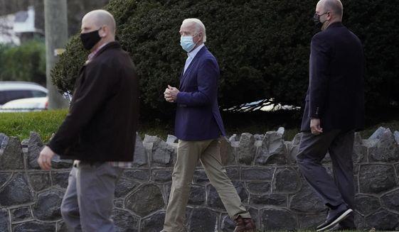 President-elect Joe Biden leaves St. Ann Parish, Saturday, Nov. 21, 2020, in Wilmington, Del. (AP Photo/Alex Brandon)