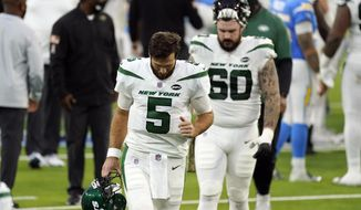New York Jets quarterback Joe Flacco (5) walks off the field after a loss to to the Los Angeles Chargers during an NFL football game Sunday, Nov. 22, 2020, in Inglewood, Calif. (AP Photo/Jae C. Hong)