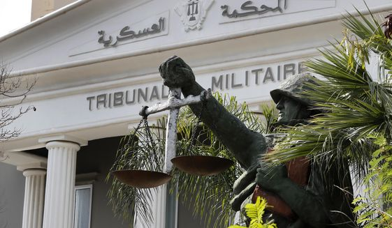 A statue of soldier carries balance, symbol of justice, is seen outside the military court in Beirut, Lebanon, Wednesday, May 27, 2020. A year after anti-government protests roiled Lebanon, dozens of protesters are being tried before military courts that human rights lawyers say grossly violate due process and fail to investigate allegations of torture and abuse. (AP Photo/Hussein Malla)