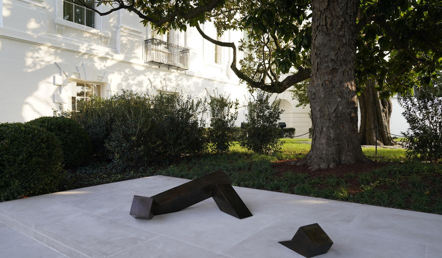 """Japanese American sculptor Isamu Noguchi's piece, titled """"Floor Frame,"""" is displayed in the White House Rose Garden on Saturday, Nov. 21, 2020, in Washington. Noguchi is the first Asian American artist to be featured in the White House collection, according to the first lady and the White House Historical Association. He died in 1988. (AP Photo/Jacquelyn Martin)"""