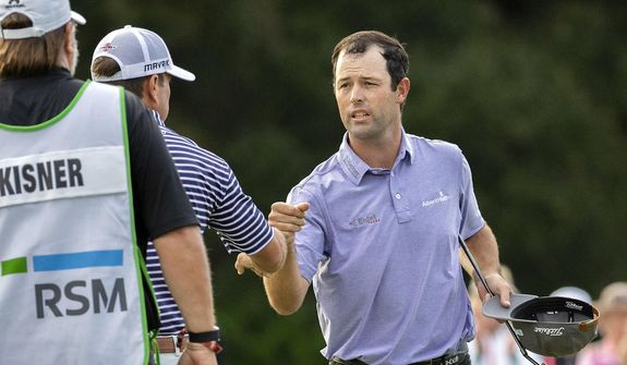 Robert Streb, right, fist-bumps Kevin Kisner after winning a second hole playoff at the RSM Classic golf tournament, Sunday, Nov. 22, 2020, in St. Simons Island, Ga. (AP Photo/Stephen B. Morton)  **FILE**