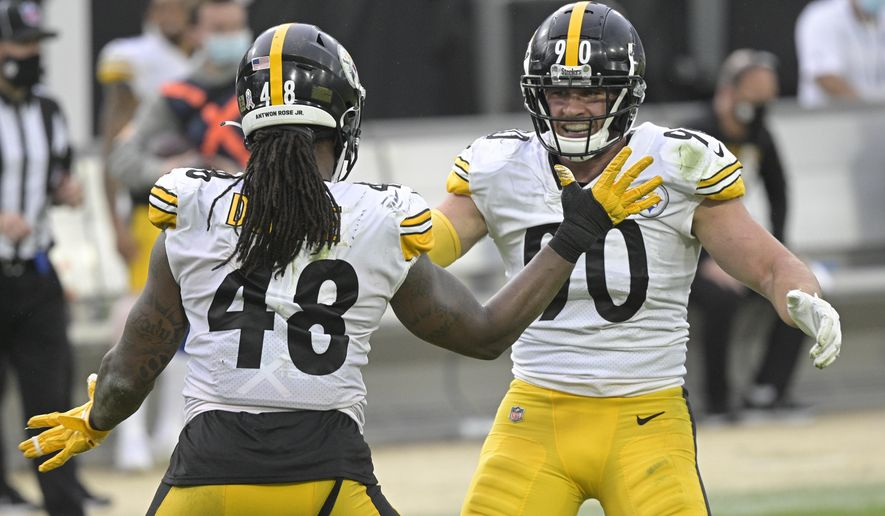 Pittsburgh Steelers linebacker Bud Dupree (48) and linebacker T.J. Watt, right, celebrate a big play against the Jacksonville Jaguars during the second half of an NFL football game, Sunday, Nov. 22, 2020, in Jacksonville, Fla. (AP Photo/Phelan M. Ebenhack)