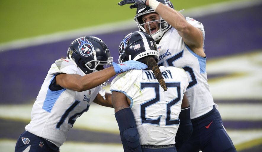 Tennessee Titans running back Derrick Henry (22) celebrates his game-winning touchdown with wide receiver Kalif Raymond, left, and tight end Anthony Firkser during overtime of an NFL football game against the Baltimore Ravens, Sunday, Nov. 22, 2020, in Baltimore. The Titans won 30-24 in overtime. (AP Photo/Nick Wass)