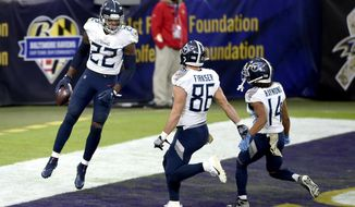 Tennessee Titans running back Derrick Henry (22) celebrates his game-winning touchdown with tight end Anthony Firkser (86) and wide receiver Kalif Raymond (14) during overtime of an NFL football game against the Baltimore Ravens, Sunday, Nov. 22, 2020, in Baltimore. The Titans won 30-24 in overtime. (AP Photo/Gail Burton)
