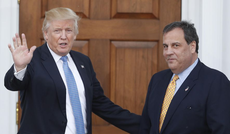 FILE - In this Nov. 20, 2016 file photo, then President-elect Donald Trump, left, waves to the media as New Jersey Gov. Chris Christie arrives at the Trump National Golf Club Bedminster clubhouse, in Bedminster, N.J. President Trump and his allies are harking back to his own transition four years ago to make a false argument that his own presidency was denied a fair chance for a clean launch. Trump fired the head of his transition, Chris Christie, and abandoned months of planning in favor of a Cabinet hiring process. His team also ignored offers of help from the outgoing Obama administration. (AP Photo/Carolyn Kaster, File)