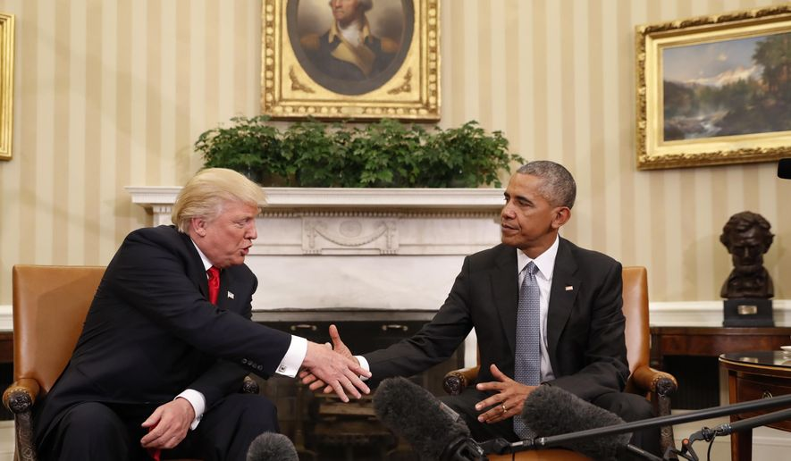 President Barack Obama shakes hands with President-elect Donald Trump in the Oval Office of the White House in Washington, Thursday, Nov. 10, 2016. (AP Photo/Pablo Martinez Monsivais) ** FILE **