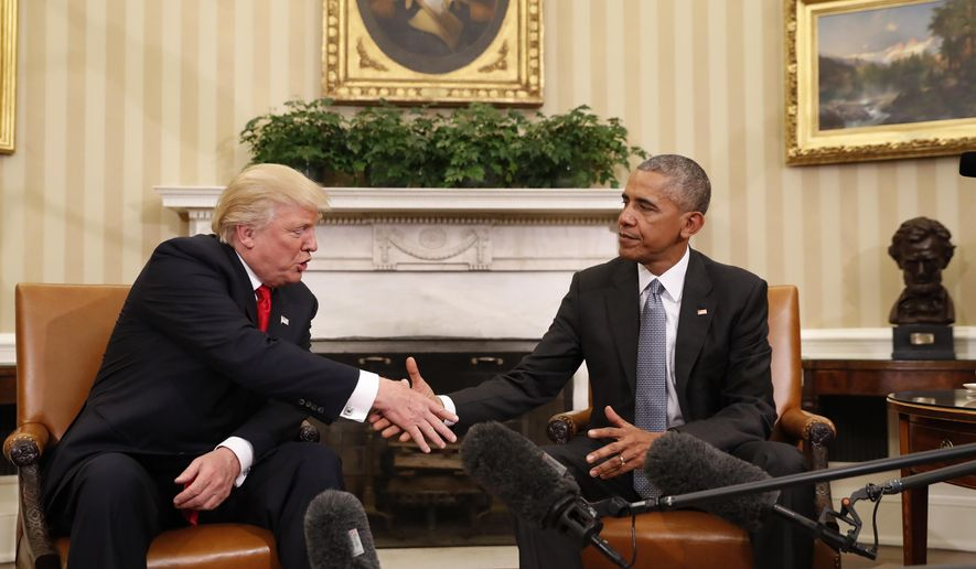 President Barack Obama shakes hands with President-elect Donald Trump in the Oval Office of the White House in Washington, Thursday, Nov. 10, 2016. President Trump and his allies are harking back to his own transition four years ago to make a false argument that his own presidency was denied a fair chance for a clean launch. Press secretary Kayleigh McEnany laid out the case from the White House podium last week. Obama, who had portrayed Trump as an existential threat to the nation, invited the president-elect to the White House and visited with him in the Oval Office. Obama's aides also offered help to Trump's incoming staffers. (AP Photo/Pablo Martinez Monsivais)
