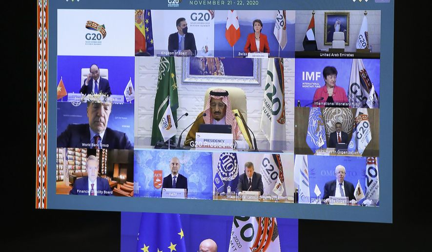 European Council President Charles Michel, on screen bottom, participates in a virtual G20 meeting, hosted by Saudi Arabia, at the European Council building in Brussels, Saturday, Nov. 21, 2020. (Yves Herman, Pool via AP)