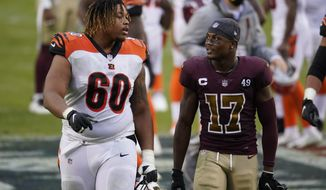 Cincinnati Bengals offensive guard Mike Jordan (60) talks with Washington Football Team wide receiver Terry McLaurin (17) as they walk off the field at the conclusion of an NFL football game, Sunday, Nov. 22, 2020, in Landover, Md. Washington won 20-9. (AP Photo/Al Drago)