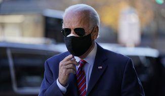 President-elect Joe Biden walks from his motorcade to speak to members of the media Monday, Nov. 23, 2020, in Wilmington, Del. (AP Photo/Carolyn Kaster)