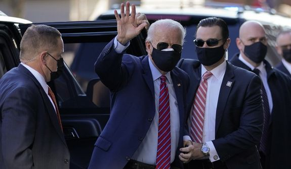 President-elect Joe Biden waves as he arrives to meet virtually with the United States Conference of Mayors at The Queen theater Monday, Nov. 23, 2020, in Wilmington, Del. (AP Photo/Carolyn Kaster)