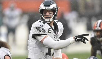 Philadelphia Eagles quarterback Carson Wentz (11) stands at the line during an NFL football game against the Cleveland Browns, Sunday, Nov. 22, 2020, in Cleveland. The Browns won 22-17. (AP Photo/David Richard)