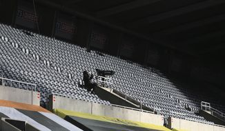 Empty stands during the English Premier League soccer match between Newcastle United v Chelsea at the St. James' Park in Newcastle, England, Saturday, Nov. 21, 2020. (Lindsey Parnaby/ Pool via AP)