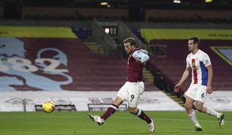 Burnley's Chris Wood, left, scores his side's opening goal during the English Premier League soccer match between Burnley and Crystal Palace at the Turf Moor stadium in Burnley, England, Monday, Nov. 23, 2020. (Jan Kruger/Pool via AP)