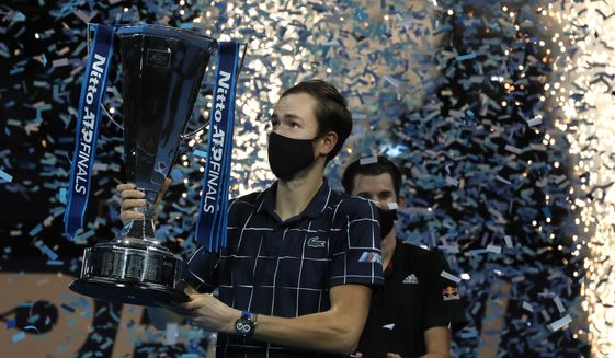 Daniil Medvedev of Russia holds up the winners trophy as confetti falls after defeating Dominic Thiem of Austria in the final of the ATP World Finals tennis match at the ATP World Finals tennis tournament at the O2 arena in London, Sunday, Nov. 22, 2020. (AP Photo/Frank Augstein)  **FILE**