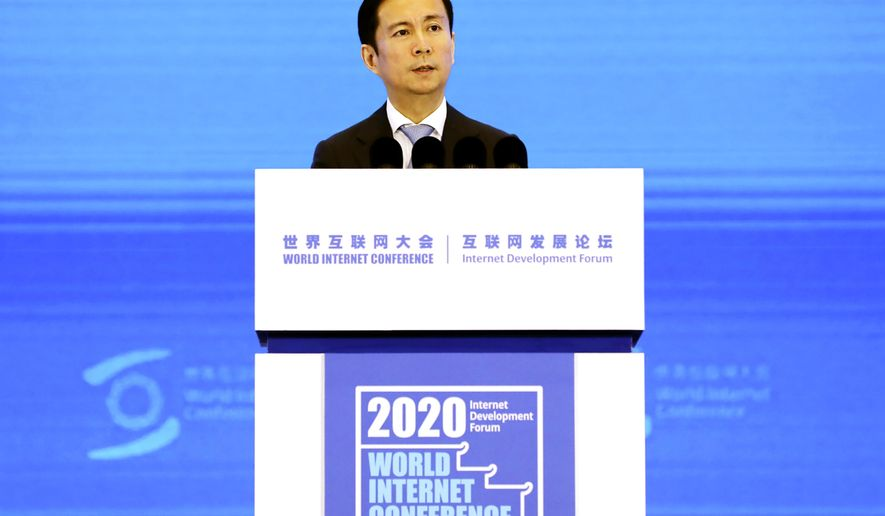 Daniel Zhang, Chairman and CEO of Alibaba Group, delivers a speech at the World Internet Conference in Wuzhen in east China's Zhejiang province Monday, Nov. 23, 2020. Zhang praised Chinese regulators Monday in a possible attempt to repair ties after the stock market debut of its former financial services arm was suspended following criticism of them by billionaire Alibaba founder Jack Ma. (Chinatopix Via AP)