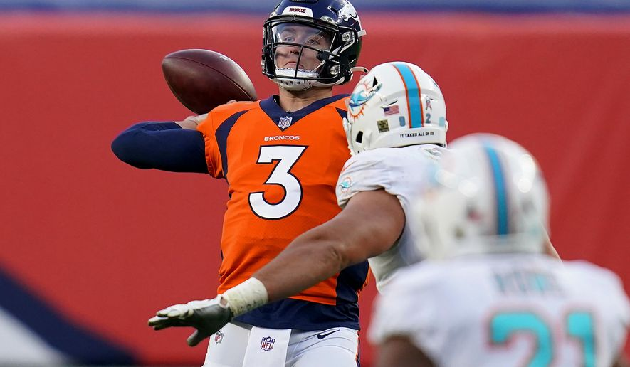 Denver Broncos quarterback Drew Lock (3) throws under pressure from Miami Dolphins defensive end Zach Sieler during the second half of an NFL football game, Sunday, Nov. 22, 2020, in Denver. (AP Photo/David Zalubowski)