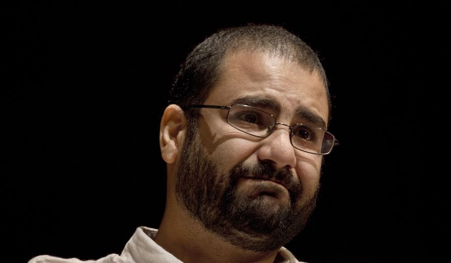 FILE - In this Sept. 22, 2014, file photo, Egypt's leading pro-democracy activist Alaa Abdel-Fattah takes a moment as he speaks about his late father Ahmed Seif, one of Egypt's most respected human rights lawyers, during a conference held at the American University in Cairo, Egypt. An Egyptian court placed nearly 30 people, including Abdel-Fattah and an Islamist politician, on a terrorism watch list over accusations they joined the banned Muslim Brotherhood, the official gazette reported Monday, Nov. 23, 2020. (AP Photo/Nariman El-Mofty, File)
