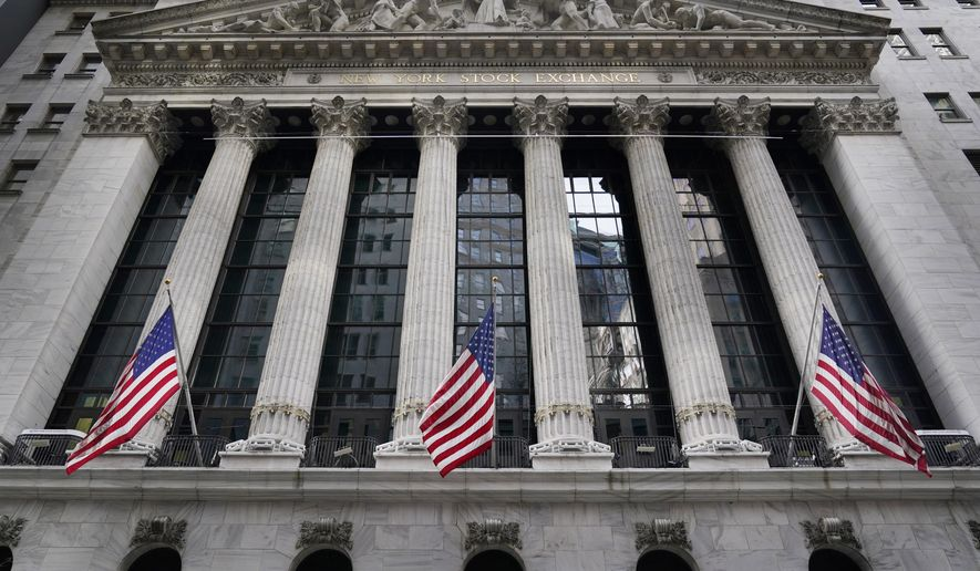 The New York Stock Exchange is seen in New York, Monday, Nov. 23, 2020. Stocks are off to a good start on Wall Street Monday after AstraZeneca said that late-stage trials showed that its coronavirus vaccine was up to 90% effective. The S&P 500 rose 0.9% in the early going Monday following a loss last week. (AP Photo/Seth Wenig)