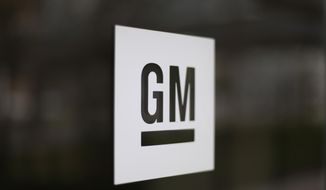 This Friday, May 16, 2014, file photo, shows the General Motors logo at the company's world headquarters in Detroit. The U.S. is making General Motors recall and repair nearly 6 million big pickup trucks and SUVs equipped with potentially dangerous Takata air bag inflators. The move announced Monday, Nov. 23, 2020, by the National Highway Traffic Safety Administration will cost the automaker an estimated $1.2 billion. (AP Photo/Paul Sancya, File)