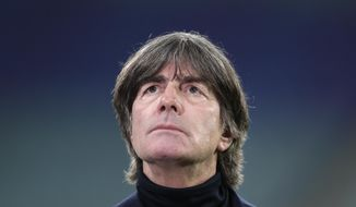 German manager Joachim Low is interviewed ahead of the UEFA Nations League soccer match between Germany and the Ukraine at the Red Bull Arena in Leipzig, Germany, Saturday, Nov. 14, 2020. (AP Photo/Michael Sohn)
