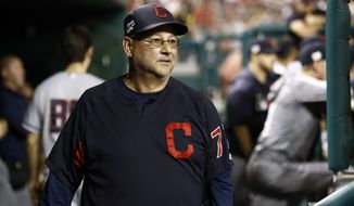 FILE - In this Sept. 27, 2019 file photo, Cleveland Indians manager Terry Francona walks in the dugout in the ninth inning of a baseball game against the Washington Nationals in Washington.  Francona has assembled his coaching staff for 2021, but it won't include his longtime friend and bench coach Brad Mills. Francona, who missed much of this past shortened season with significant health issues, will replace Mills with DeMarlo Hale. The 59-year-old Hale joins the Indians after spending the past two seasons with the Atlanta Braves. (AP Photo/Patrick Semansky, File)