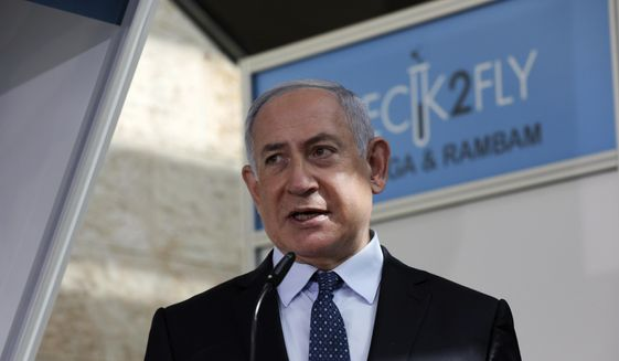 In this Nov. 9, 2020, file photo, Israeli Prime Minister Benjamin Netanyahu visits a new coronavirus lab at Ben-Gurion International Airport, near Tel Aviv, Israel. Israeli media reported Monday, Nov. 23, 2020, that Netanyahu flew to Saudi Arabia for a clandestine meeting with Crown Prince Mohammed bin Salman, which would mark the first known encounter between senior Israeli and Saudi officials. (Ohad Zwigenberg/Pool Photo via AP, File)  **FILE**