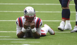 New England Patriots quarterback Cam Newton (1) reacts after failing to complete a pass on fourth down during the second half of an NFL football game against the Houston Texans, Sunday, Nov. 22, 2020, in Houston. (AP Photo/Eric Christian Smith)