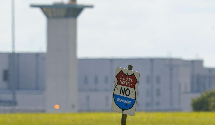 """In this Aug. 26, 2020, file photo, the federal prison complex in Terre Haute, Ind. A Justice Dept. inspector general report released July 7, 2021, finds that there are only 236 chaplains to serve more than 160,000 federal prison inmates and that two-thirds of U.S. Bureau of Prison (BOP) facilities are not meeting staffing minimums, forcing some prisons to turn to """"alternatives that pose enhanced risks."""" (AP Photo/Michael Conroy, File)  **FILE**"""