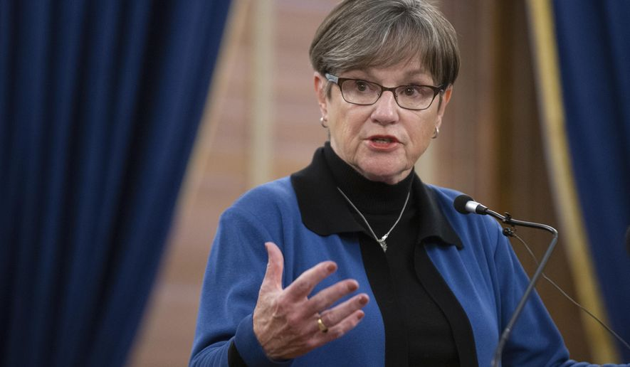 Gov. Laura Kelly gives an update on COVID-19 in the state during a press conference at the Statehouse where she implemented a mask protocol in an executive order Wednesday, Nov. 18, 2020, in Topeka, Kan. (Evert Nelson/The Topeka Capital-Journal via AP)