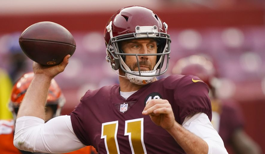 Washington Football Team quarterback Alex Smith (11) throws the ball in the second half of an NFL football game against the Cincinnati Bengals, Sunday, Nov. 22, 2020, in Landover, Md. Washington won 20-9. (AP Photo/Andrew Harnik)