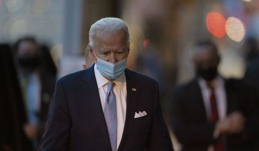 President-elect Joe Biden walks to speak to the media as he leaves The Queen theater, Tuesday, Nov. 24, 2020, in Wilmington, Del. (AP Photo/Carolyn Kaster)