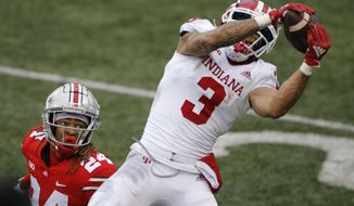 Indiana receiver Ty Fryfogle, right, catches a pass for a touchdown over Ohio State defensive back Shaun Wade during the second half of an NCAA college football game Saturday, Nov. 21, 2020, in Columbus, Ohio. Ohio State beat Indiana 42-35. (AP Photo/Jay LaPrete)