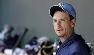 FILE - Tampa Bay Rays starting pitcher Charlie Morton sits in the dugout after pitching against the Baltimore Orioles in a spring training baseball game Tuesday, Feb. 25, 2020, in Sarasota, Fla. The Atlanta Braves have added another veteran arm to their rotation by signing two-time All-Star Charlie Morton to a $15 million, one-year deal. The signing comes after left-hander Drew Smyly signed an $11 million, one-year deal with the Braves on Nov. 16. (AP Photo/John Bazemore)