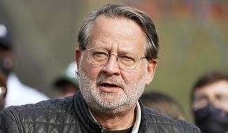 Sen. Gary Peters, D-Mich., addresses the media, Thursday, Nov. 5, 2020, in Rochester, Mich. (AP Photo/Carlos Osorio)