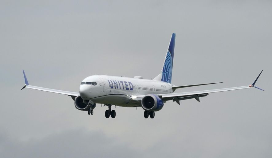 A Boeing 737 Max 9 built for United Airlines flies before landing at King County International Airport - Boeing Field after a test flight from Moses Lake, Wash., Wednesday, Nov. 18, 2020, in Seattle. After nearly two years and a pair of deadly crashes, the U.S. Federal Aviation Administration announced Wednesday that the 737 Max has been cleared for flight after regulators around the world grounded the Max in March 2019, after the crash of an Ethiopian Airlines jet. (AP Photo/Ted S. Warren)