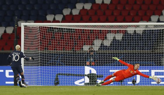 PSG's Neymar, left, scores his side's opening goal from penalty during the Champions League group H soccer match between Paris Saint Germain and RB Leipzig at the Parc des Princes stadium in Paris, Tuesday Nov. 24, 2020. (AP Photo/Thibault Camus)