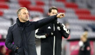 Bayern's head coach Hans-Dieter Flick gives instructions to his players during the German Bundesliga soccer match between FC Bayern Munich and SV Werder Bremen in Munich, Germany, Saturday, Nov. 21, 2020. (AP Photo/Matthias Schrader)