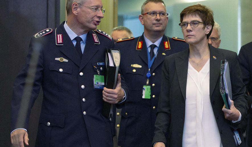 FILE - In this Thursday, Oct. 24, 2019 file photo German Defense Minister Annegret Kramp Karrenbauer, front right, arrives for a meeting of NATO defense ministers at NATO headquarters in Brussels, Belgium. Germany's defense minister on Tuesday rejected Turkish complaints over the search of a Turkish freighter in the Mediterranean Sea by a German frigate participating in a European mission, insisting that German sailors behaved correctly. (AP Photo/Virginia Mayo, file)