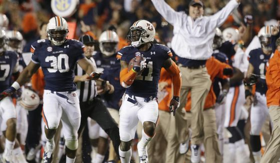 FILE - In this Nov. 30, 2013, file photo, Auburn cornerback Chris Davis (11) returns a field goal attempt 109-yards to score the winning touchdown over Alabama during the second half of an NCAA college football game in Auburn, Ala. Davis' 109-yard return of a missed field goal to beat Alabama was one of the Iron Bowl's most memorable plays. (AP Photo/Dave Martin, File)
