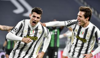 Juventus' Alvaro Morata celebrates a goal with teammate Federico Chiesa during the Champions league, group G soccer match between Juventus and Ferencvaros, at the Allianz Stadium in Turin, Italy, Tuesday, Nov. 24, 2020. (Marco Alpozzi/LaPresse via AP)