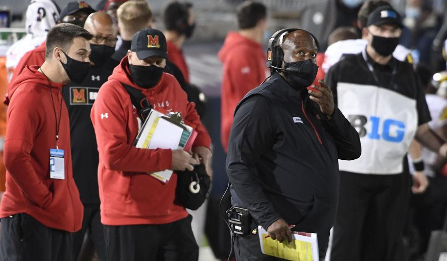 In this Nov.  7, 2020, file photo, Maryland head coach Mike Locksley looks up from the sideline during the fourth quarter of an NCAA college football game against Penn State in State College, Pa. Locksley remains on lockdown, battling the coronavirus while the Terrapins prepare for their first game in three weeks without nearly two dozen players who tested positive for COVID-19.  (AP Photo/Barry Reeger, File) **FILE**