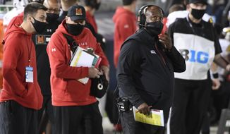 FILE - In this Nov.  7, 2020, file photo, Maryland head coach Mike Locksley looks up from the sideline during the fourth quarter of an NCAA college football game against Penn State in State College, Pa. Locksley remains on lockdown, battling the coronavirus while the Terrapins prepare for their first game in three weeks without nearly two dozen players who tested positive for COVID-19.  (AP Photo/Barry Reeger, File