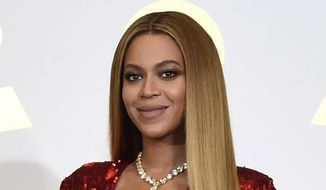 In this Feb. 12, 2017, file photo, Beyonce poses in the press room at the 59th annual Grammy Awards in Los Angeles. The pop star scored multiple Grammy nominations Tuesday, making her the leading contender with nine nominations. (Photo by Chris Pizzello/Invision/AP, File)