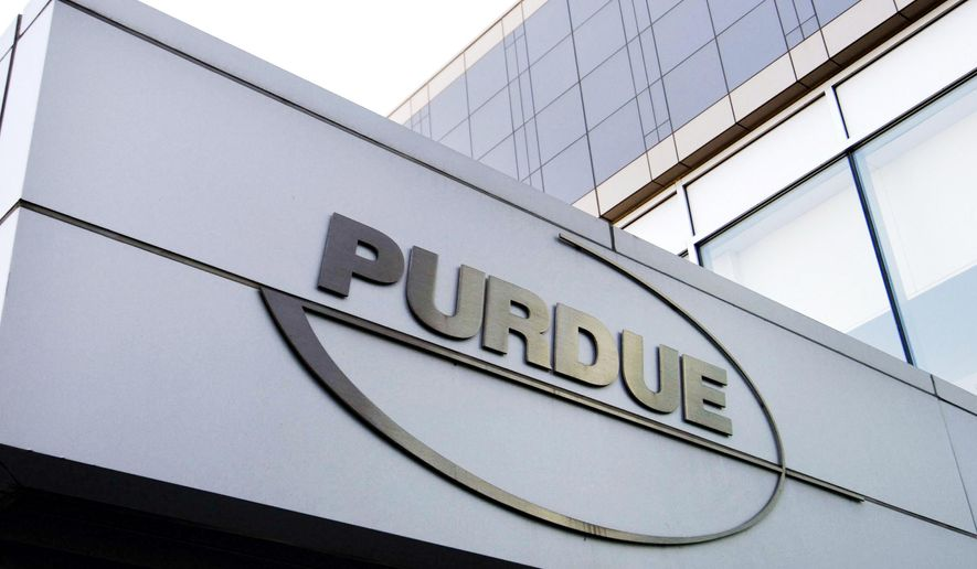 In this Tuesday, May 8, 2007, file photo, a Purdue Pharma logo is affixed to part of a Purdue building in Stamford, Conn. (AP Photo/Douglas Healey, File)
